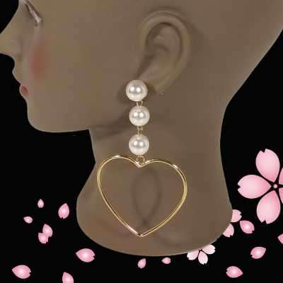 Gold-Tone Pearl Heart Shaped Earrings Profile Picture